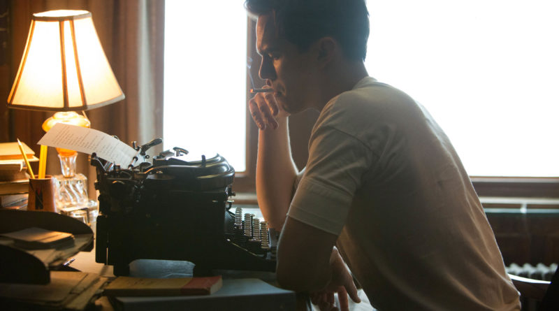 Nicholas Hoult frantically writing away as J.D. Salinger in REBEL IN THE RYE.